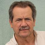 Dr. Carlos De Castro